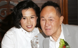 Gigi Chao (Left) and her father Cecil Chao Sze-tsung.